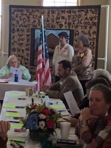 Jonita Sommers reading installation of officers--Brenda Brenda Carnahan, secretary and Terrie Springman, treasurer.
