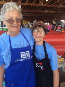 Becky Downs and granddaughter working at 2016 Philly Cheese Steak booth